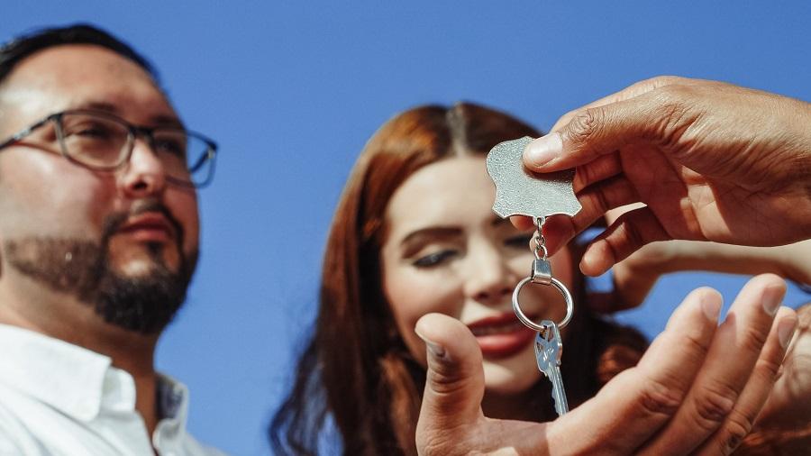 Handing giving keys to home buyers