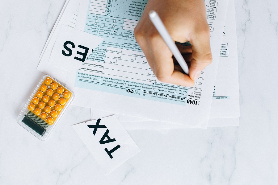 A person filling out a tax form