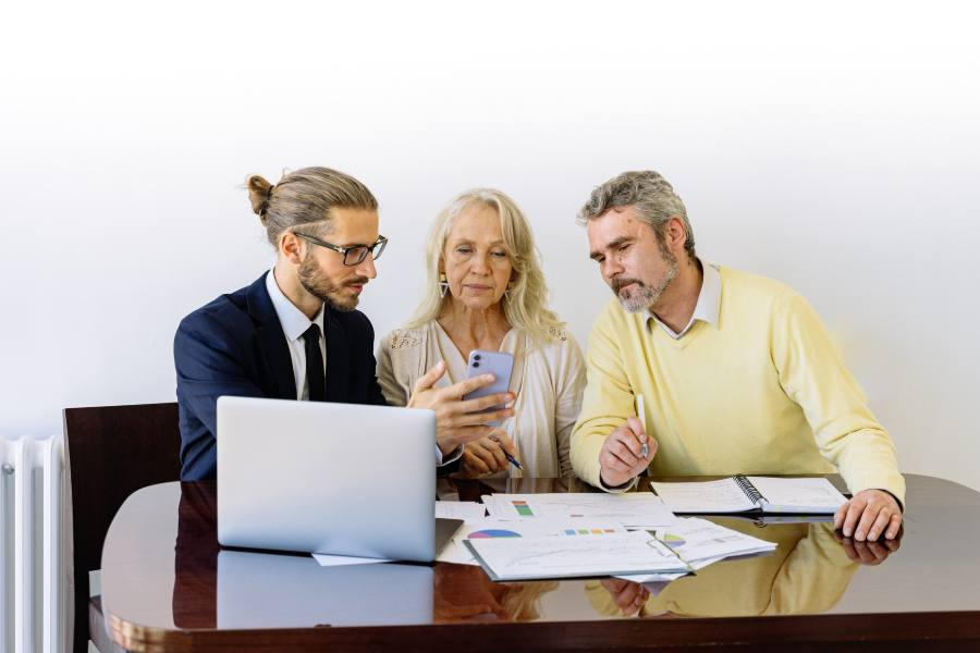 An old couple meeting with a real estate agent